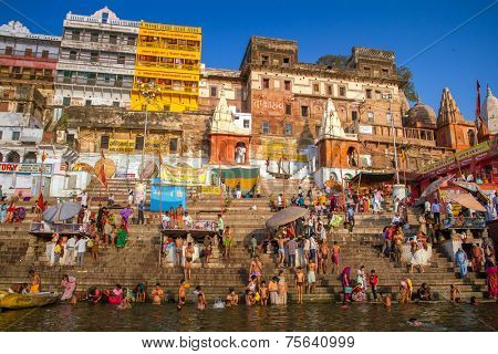 VARANASI, INDIA - MARCH 23: Hindu pilgrims take holy bath in the river ganges on the auspicious Maha Shivaratri festival on March 23, 2013 at Dasashwamedh ghat in Varanasi, Uttar Pradesh, India