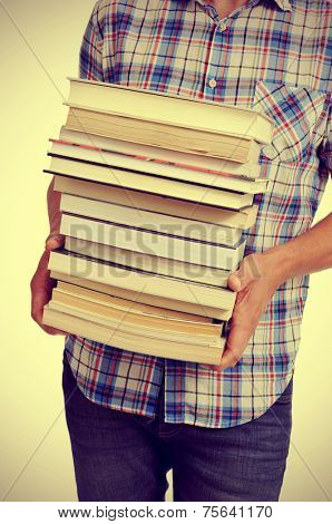 young man carrying a pile of books, with a filter effect
