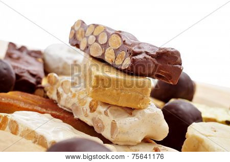 closeup of a tray with pieces of different turron, typical Christmas sweet food in Spain