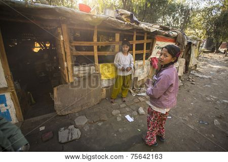 KATHMANDU, NEPAL - DEC 16, 2013: Unidentified poor people near their houses at slums in Tripureshwor district. Caste of untouchables in Nepal, is about 7 % of population.