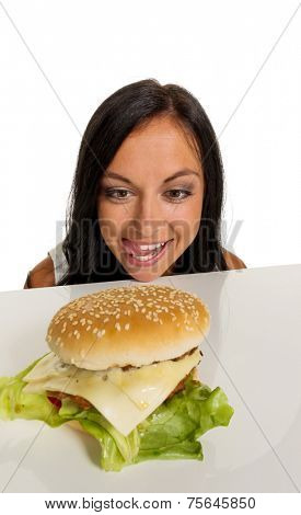 a young woman with a hamburger. fast food and quick meals
