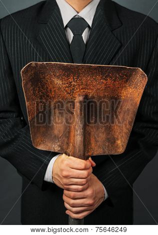 Unrecognizable Businessman Holding Metal Shovel