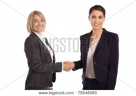 Team: Two isolated businesswoman shaking hands wearing business outfit