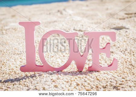 love word on natural tropical background, beach wedding concept