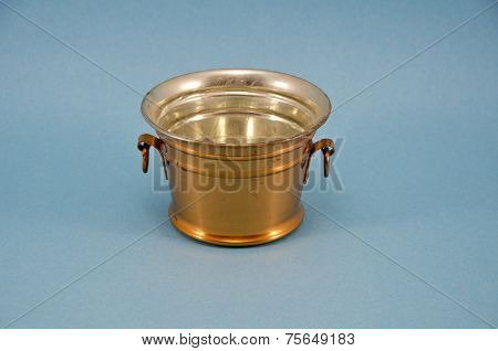 Brass Bowl Vase On Blue Background