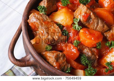 Stew In Tomato Sauce With Vegetables In A Pot Macro Top View