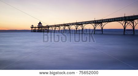 Beautiful Long Exposure Sunset Over Ocean With Pier Silhouette