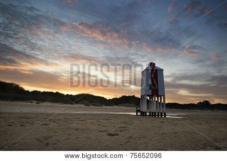 Sunrise Landscape Of Wooden Stilt Lighthouse On Beach In Summer