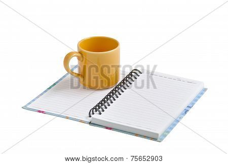 Mug On Note Book