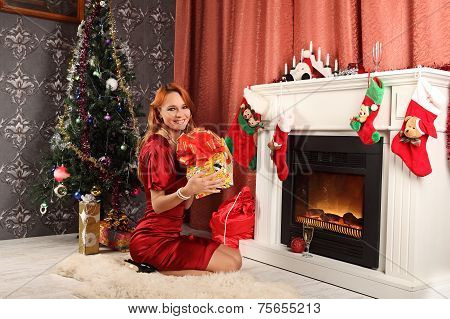 Beautiful Woman Near The Fireplace In Winter House. Selebrating Christmas
