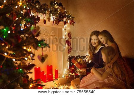 Christmas Family Woman Portrait, Mother And Daughters Celebrate Holiday, Opening Present Gift Box