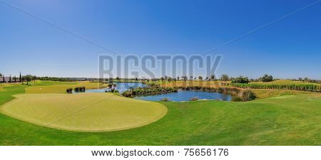 Summer Panorama Of The Golf Course. On The Lake.