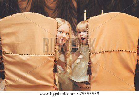Christmas, Celebration, Holiday, Xmas Concept - Cute Children Sit At The Table