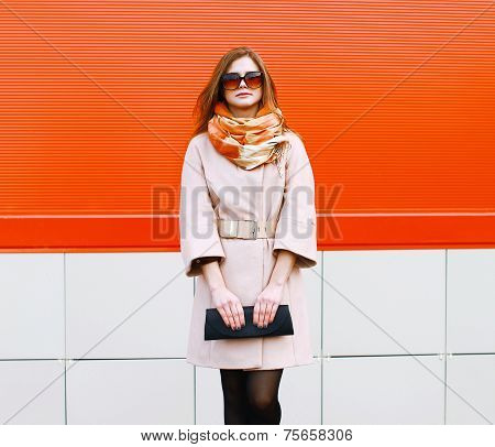 Street Fashion Pretty Stylish Woman Model In Coat And Sunglasses With Bag Clutch Posing Outdoors Aga
