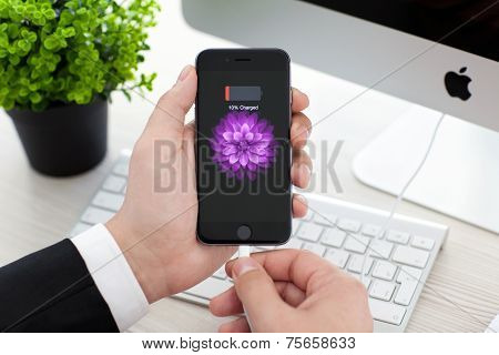 Man Holding Iphone 6 Space Gray With Battery Icon