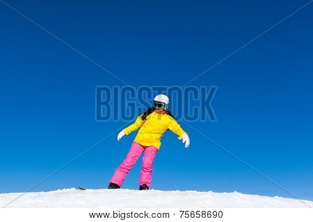 snowboarder girl making stunt trick on snowboard