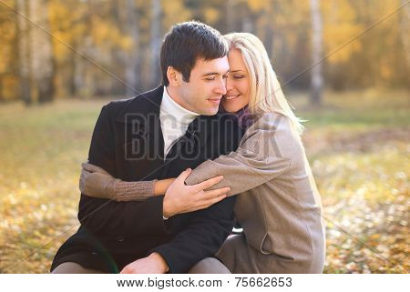 Autumn, Love, Relationship And People Concept - Happy Pretty Young Couple In Love Outdoors In Autumn