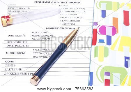 Filling In The Blood Test Blank With A Pen And Next  Vial