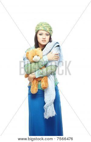 traurige Dame mit Spielzeug