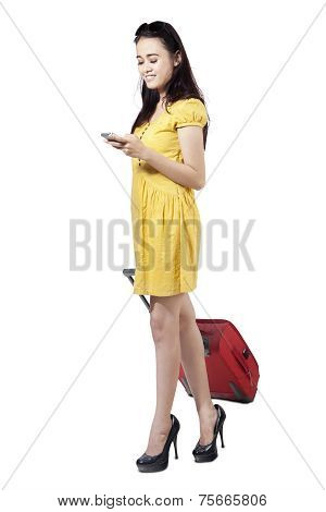 Beautiful Girl Using Cellphone And Pull Luggage