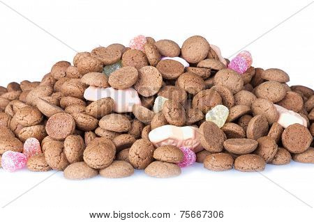 Heap Of Dutch Ginger Nuts And Sweets Isolated Over White