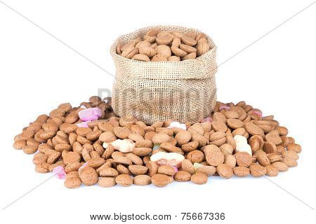 Jute Bag Filled With Ginger Nuts Isolated Over White