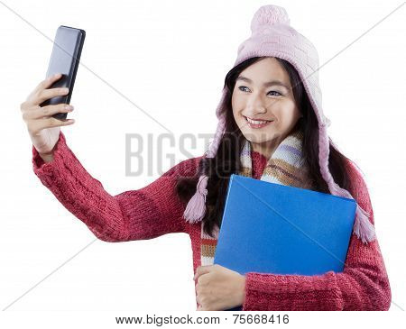 Girl In Winter Clothes Taking Self Portrait
