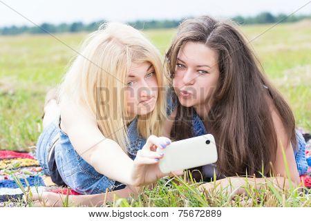 Friends Grimacing And Making Selfie