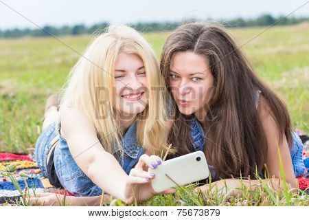 Friends Laughing And Making Selfie