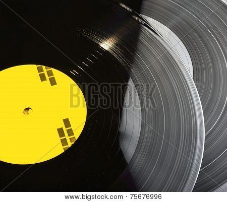 Black vinyl records stacked up
