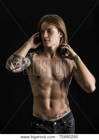 Muscular Man Shirtless Listening To Music On Headphones