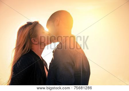 Couple At Sunset Kissing Themselves