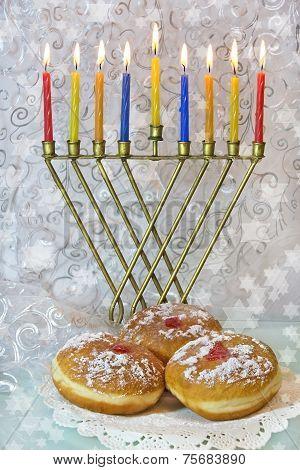 Hanukkah Menorah And Traditional Doughnuts