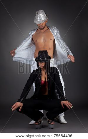 Two mysterious striptease dancers posing at camera