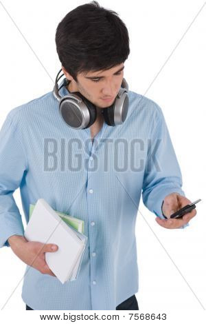 Male Student Sending Text Message Holding Books