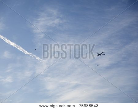 Airplane In Clouds Background.