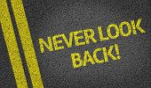 image of saying sorry  - Never Look Back written on the road - JPG