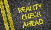picture of realism  - Reality Check Ahead written on the road - JPG