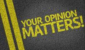 picture of soliciting  - Your Opinion Matters written on the road - JPG