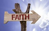 stock photo of evangelism  - Faith wooden sign on a beautiful day - JPG