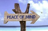 stock photo of experiments  - Peace of Mind wooden sign with a beach on background  - JPG