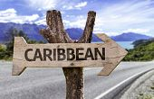 stock photo of greater antilles  - Caribbean wooden sign with a highway on background - JPG