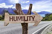foto of humility  - Humility wooden sign with a street on background  - JPG
