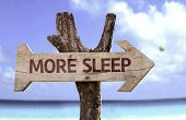 stock photo of breath taking  - More Sleep wooden sign with a beach on background - JPG
