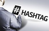 image of hashtag  - Business man with the text Hashtag in a concept image - JPG