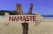 pic of namaste  - Namaste wooden sign with a beach on background - JPG