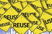 stock photo of waste reduction  - Reuse written on multiple road sign - JPG