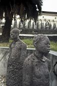 image of inhumane  - Stone sculpture of slave in stonetown Zanzibar - JPG