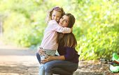 stock photo of children walking  - Mother and child walking in park outdoors - JPG