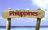 stock photo of cebu  - Philippines wooden sign with a beach on background - JPG